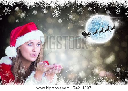 Festive blonde blowing over hands against black abstract light spot design