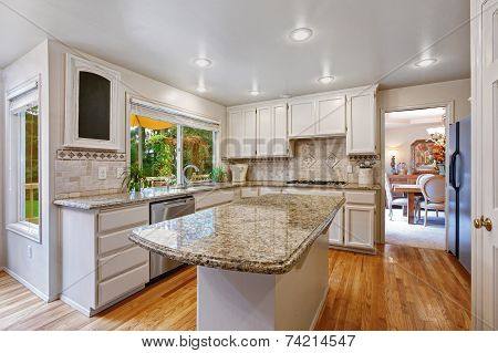 Kitchen Room With White Storage Combination And Island