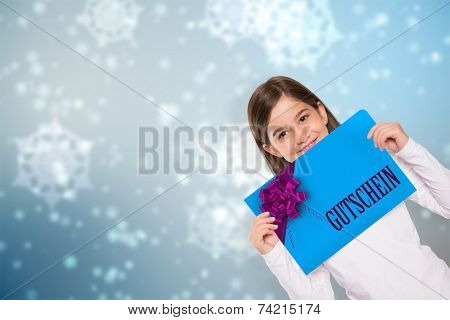 Cute little girl showing card against digitally generated delicate snowflake design poster