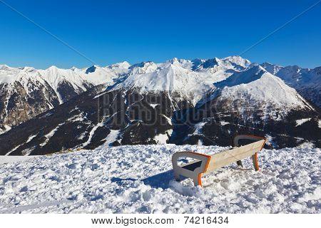 Bench at mountains ski resort Bad Gastein Austria - nature and sport background