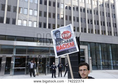 Picket sign in front of 26 Federal Plaza