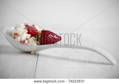 Vanilla And Strawberry Ice Cream On Spoon