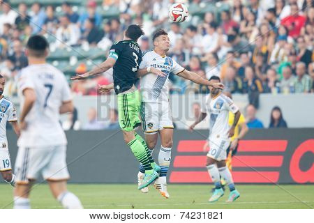 CARSON, CA - OCT 19: Brad Evans & Robbie Rogers fight for the ball during the Los Angeles Galaxy MLS game against the Seattle Sounders on October 19th 2014 at the StubHub Center.