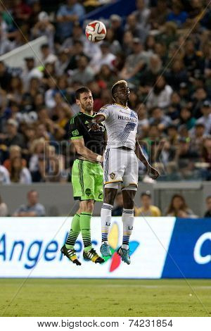 CARSON, CA - OCT 19: Gyasi Zardes & Zach Scott (L) in action during the Los Angeles Galaxy MLS game against the Seattle Sounders on October 19th 2014 at the StubHub Center.