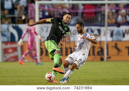 CARSON, CA - OCT 19: Clint Dempsey & Marcelo Sarvas (R) in action during the Los Angeles Galaxy MLS game against the Seattle Sounders on October 19th 2014 at the StubHub Center.