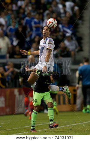 CARSON, CA - OCT 19: Alan Gordon (top) & DeAndre Yedlin in action during the Los Angeles Galaxy MLS game against the Seattle Sounders on October 19th 2014 at the StubHub Center.