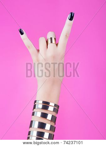woman hand giving the devil horns gesture (isolated on white background) poster