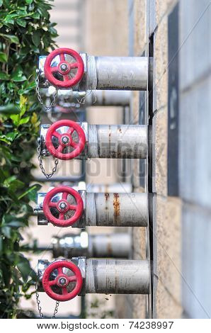 Multiple Fire Department Connections On A Building Wall