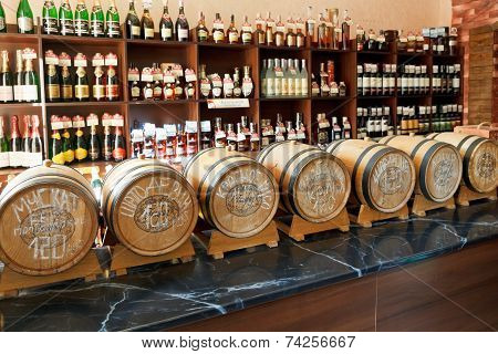 Crimean Wine In Barrels And Bottles In Shop