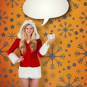 Pretty girl in santa outfit holding gift against yellow vignette poster