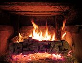 Close up image of a rustic wood stove fire poster