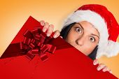 Woman surprised at the camera against red christmas ribbon poster