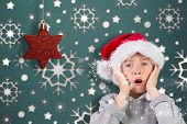 Festive surprised boy against snowflake wallpaper pattern poster