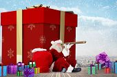 Santa looking through a telescope against balcony overlooking city poster