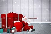 Santa looking through a telescope against grey room poster