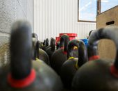Selective focus of kettlebells at cross fitness box poster