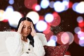 Woman suffering from a migraine against blurred lights poster