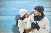 Young winter couple against blurred wooden planks poster