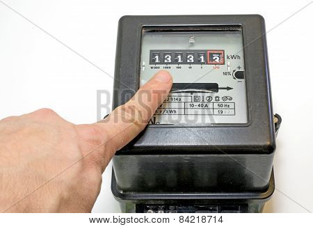 Finger And 13 Number On The Electricity Meter