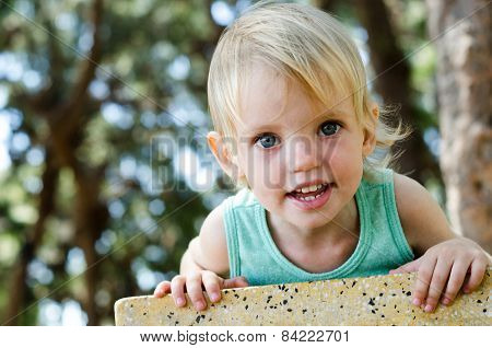 Adorable Toddler Girl Looking Right In Camera Shallow Focus