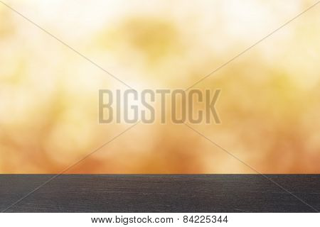 blurred background of orange yellow foliage with rock surface