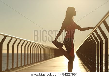 Runner Silhouette Doing Stretching Exercise