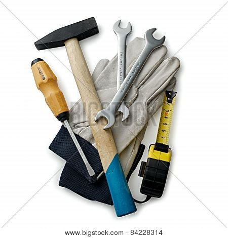 Assorted Hand Tools And Gloves On White Background