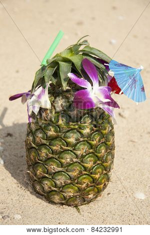 Green pineapple cocktail on the beach