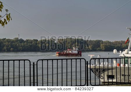 Tugboat pass along the Ruse port at Danube river