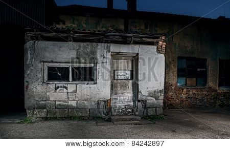 Old Cracked Or Grungy House With Brocken Doors And Windows. Urban Background