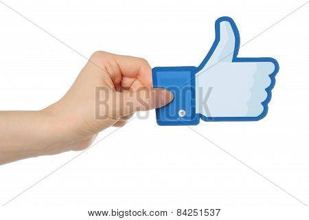 KIEV UKRAINE - JANUARY 24 2015: Hand holds facebook thumbs up sign