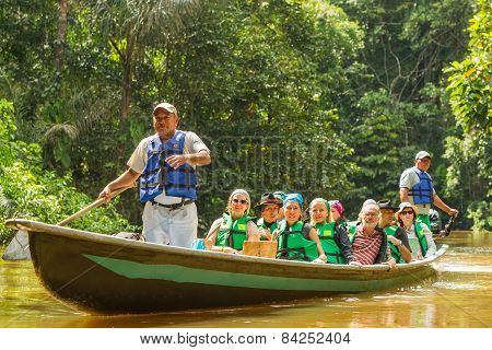 Cuyabeno, Ecuador - 20 March 2015: Middle Age European Biologists In The Canoe Crossing Cuyabeno River, South America In Cuyabeno On March 20, 2015