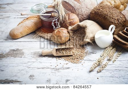 Bakery Bread.Various Bread and Sheaf of Wheat Ears Still-life