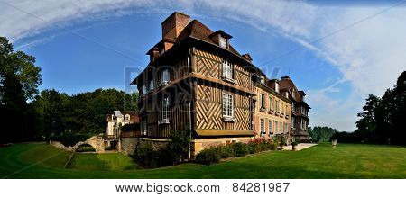 beautiful castle with garden and blue sky in france panorama