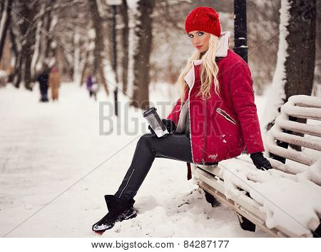 Fashion Woman With Coffee Outdoors