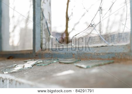 Broken Glass At Window Of Old Industrial Building