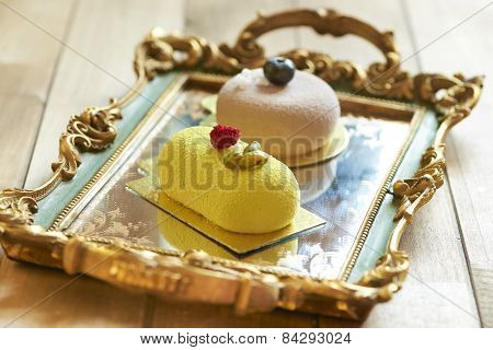 Two beautiful cakes on vintage tray