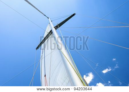 Yacht Mast Against Blue Skies