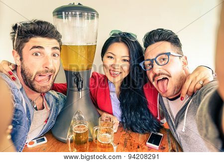 Happy Friends Taking Selfie With Funny Tongue Out Near Beer Tower Dispenser - Concept Of Friendship