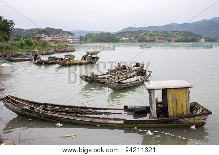 XIAPU, CHINA - JUNE 4, 2015: Fishermen's boats anchored near the shore at a fishermen's village. Xiapu is a major fishermen's port and has an important seafood farming industry in China.