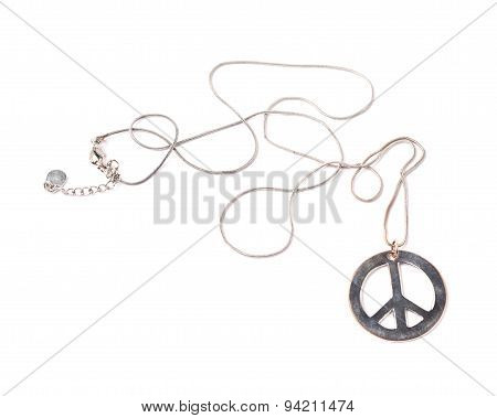 Worn metal peace sign necklace isolated