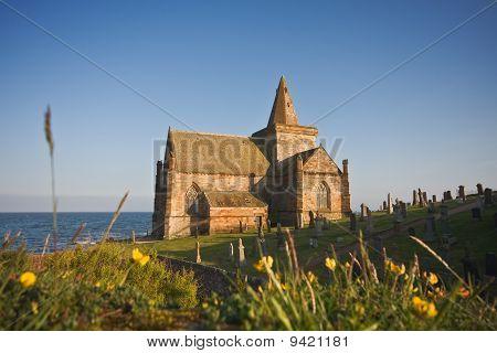 Coastal Church In Scotland On A Sunny Afternoon