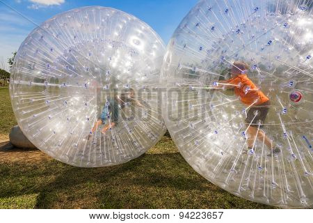 Children Have Fun In The Ball