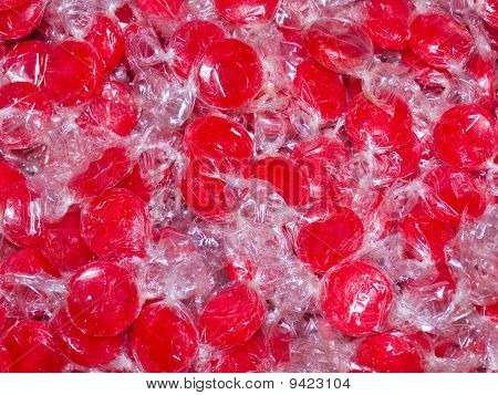 Colorful Hard Candy In Wrappers As A Background