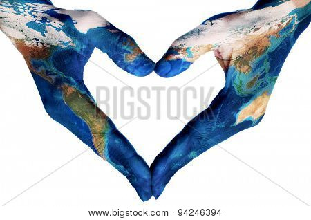the hands of a young woman forming a heart patterned with a world map (furnished by NASA), on a white background