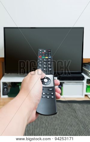 Hand Holding And Pointing Remote Control