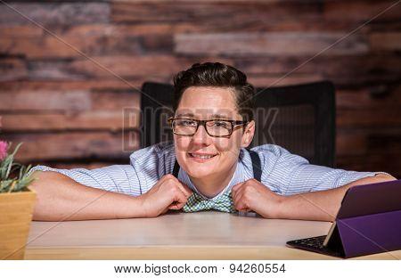 Happy Boyish Boss At Desk
