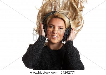 A pretty blonde Latina girl rocking out and flinging her hair while listening to large black studio headphones. Isolated on a white background. poster