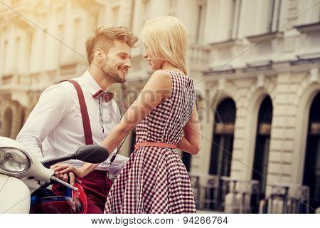 Young funny pretty fashion vintage hipster couple having fun outdoor on the street in summer.