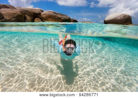 Split photo of young woman snorkeling in turquoise ocean water among granite boulders on Virgin Gorda, British Virgin Islands, Caribbean